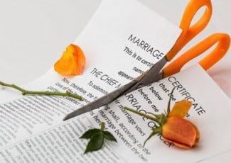 scissors cutting marriage document